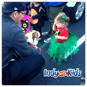 trick or treat halloween indy with kids petting a dog